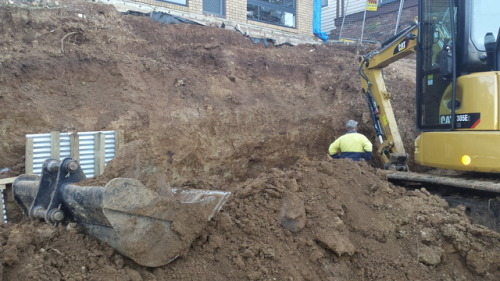 Extensive excavation underway this week on a steep and sloping